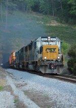 Q580 roars out of the tunnel with a trio of SD50s